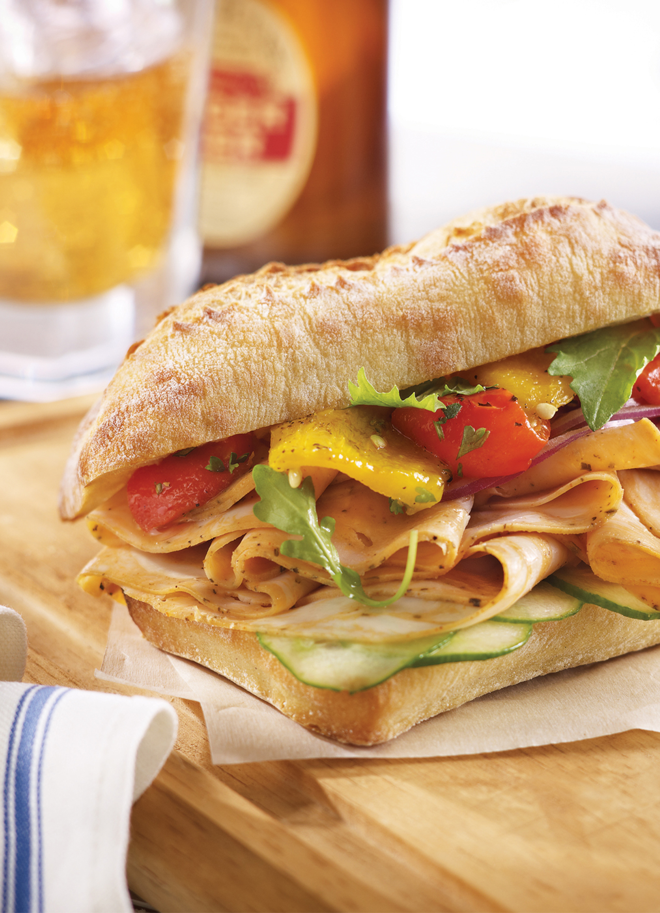 A fresh bun stuffed with Halal Chicken deli slices, peppers, cucumbers and seasonings.