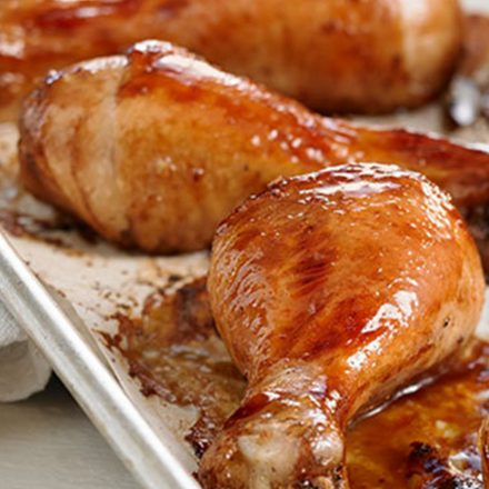 A tray of juicy, cooked drumsticks with a maple balsamic glaze