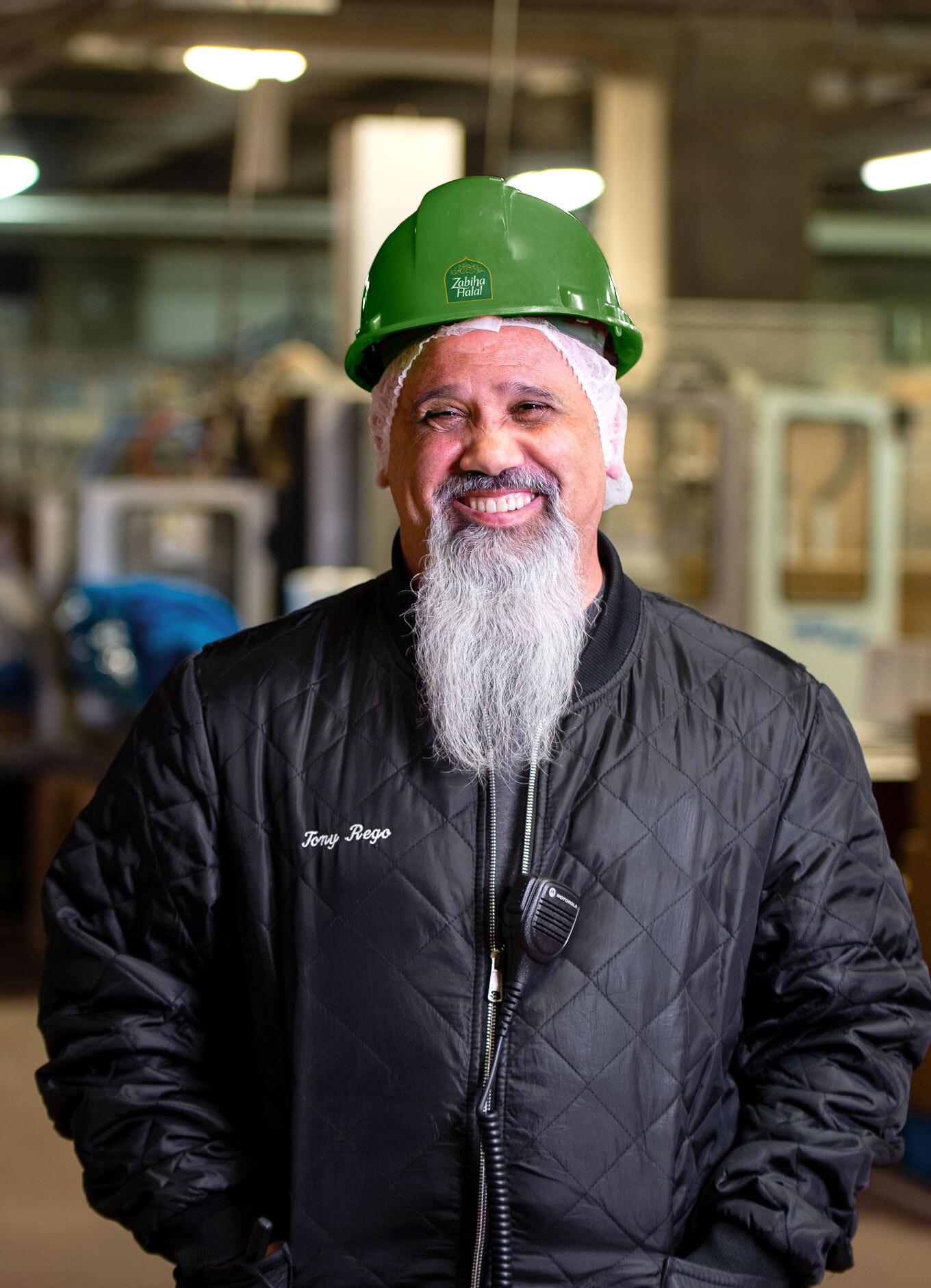 An employee at work making Zabiha Halal food