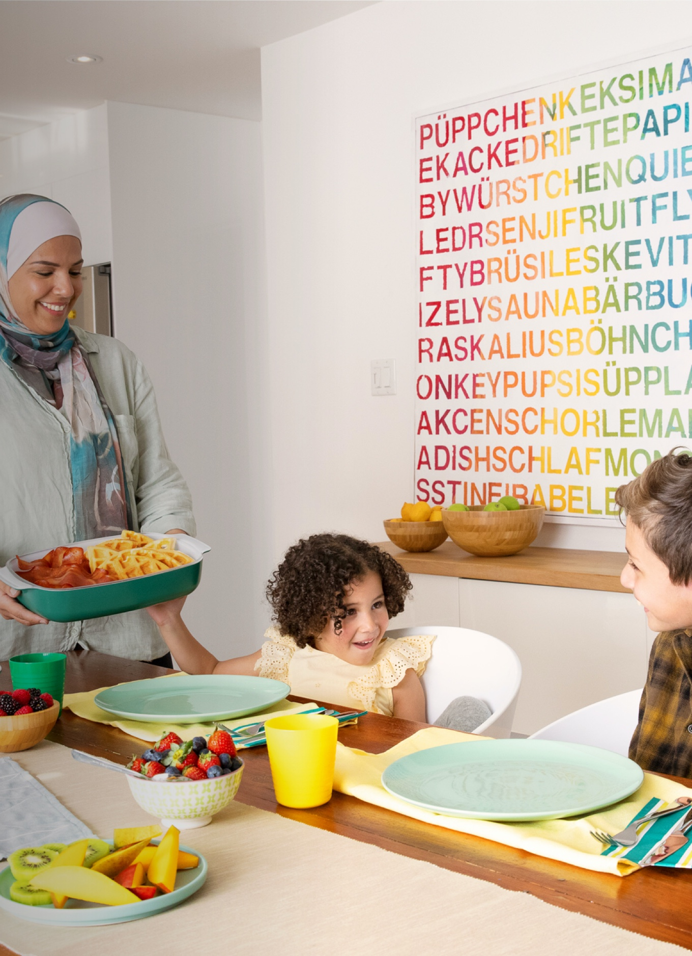 A young child ready to enjoy Halal chicken and waffles with her family.