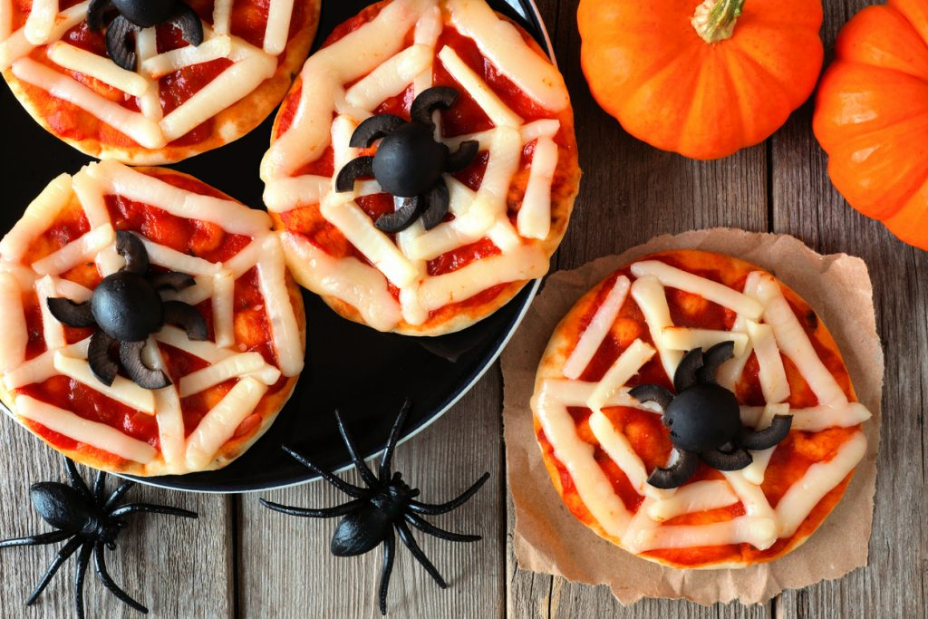 Halloween olive spiders on pizza